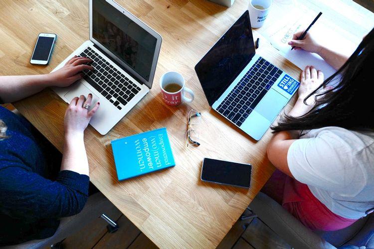 coworking women in business on computers unsplash